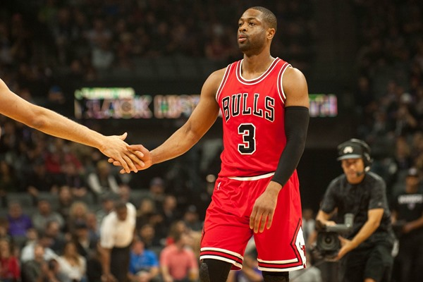 Dwyane Wade Joins Jimmy Butler on the Bench for the Bulls Against the Warriors
